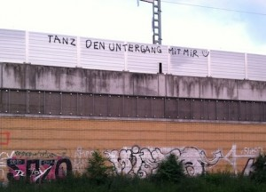 """Sponti-graffiti"" spotted from the train on the way to the Wedding S-Bahn station. It says ""Tanz den Untergang mit mir"" (Dance [into] the downfall with me) © Virag Molnar"