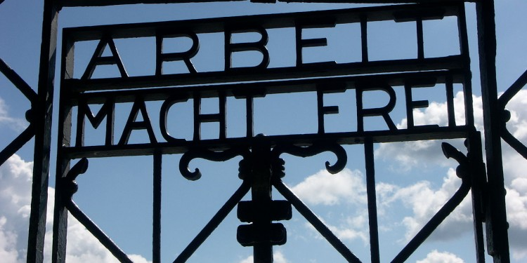 "Detail of the main gate at Dachau concentration camp in Germany, displaying  ""Arbeit Macht Frei"" (""Work Makes You Free"") slogan. © 2007 Dorsm365 