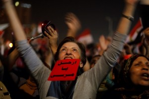 "An Egyptian protester holds a red card with Arabic that reads: ""Morsi: leave"" and shouts slogans against Egyptian President Mohammed Morsi as she watches his speech at Tahrir Square, the focal point of Egyptian uprising, in Cairo, Egypt, Wednesday, June 26, 2013. © Zamanalsamt 