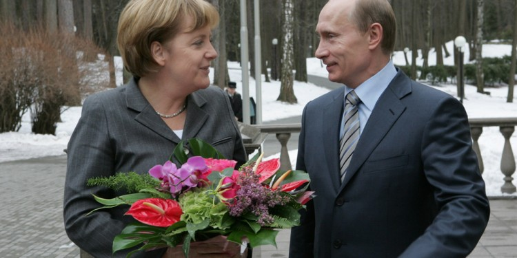 German Chancellor Angela Merkel and President Vladimir Putin meeting in Novo Ogaryovo near Moscow, 2008 © Vladimir Rodionov | RIA Novosti archive