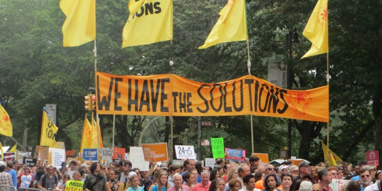 """We Have the Solutions"" banner at People's Climate March, NYC © Andrew Cheu 