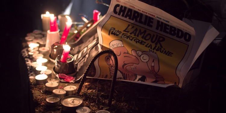 A vigil in Luxembourg for the victims of the Charlie Hebdo attack, featuring one of its controversial covers ©  Valentina Calà | Flickr