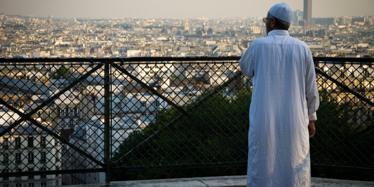A Parisian Muslim looks over the city, 2010 © Francisco Osorio | Flickr