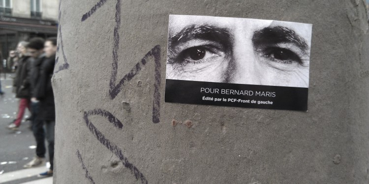 Poster honoring Bernard Maris plastered on a wall in Paris during the Solidarity March in Paris, Jan. 11, 2015.