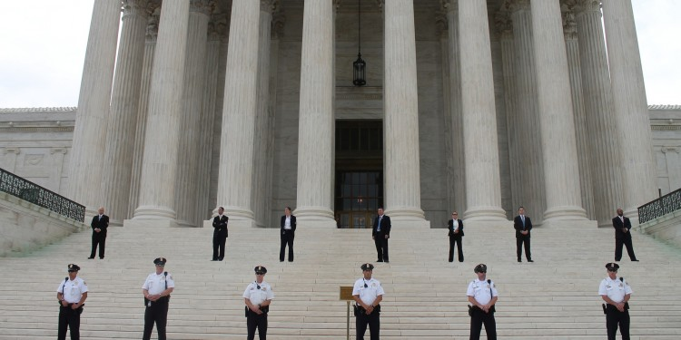 Police guarding the entrance to the Supreme Court on the date of the marriage equality rally © Elvert Barnes | Flickr
