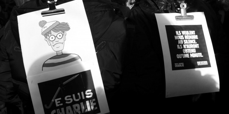 "Marchers in support of Charlie Hebdo rally in Paris wearing posters saying ""I am Charlie"" and ""We are Charlie,"" January 11, 2015 © Passion Leica 