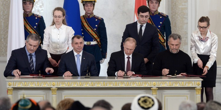 Signing of the Treaty on the adoption of the Republic of Crimea and Sevastopol to Russia. Left to right: S. Aksyonov, V. Konstantinov, V. Putin and A. Chalyi. © Kremlin.ru | Kremlin.ru/news/20604