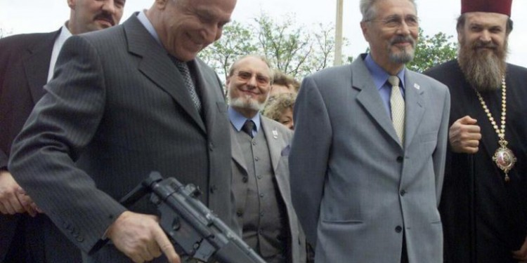 Ion Iliescu with gun © ANTI.USL | Flickr