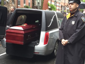 The body of Dan Berrigan leaving the funeral service, 2016 © Jeremy Varon