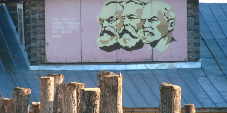 Mural of Marx-Engels-Lenin in Factory Yard - Along Rail Route to Kazan - Russia © Adam Jones | Flickr