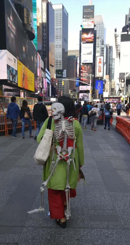 Artivism and the space(s) of democracy: Ashmina with Bipad walking along Times Square © Marina Kaneti