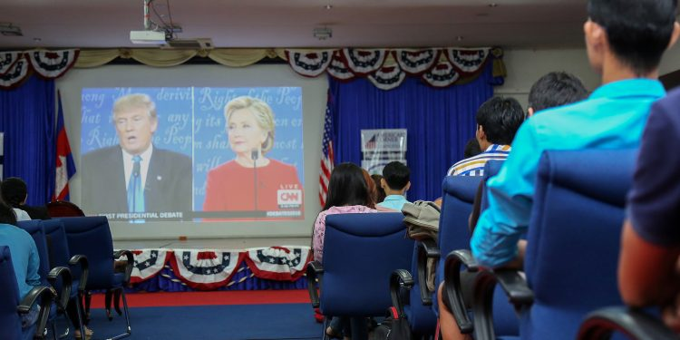 Live viewing party at the U.S. Embassy Phnom Penh, Cambodia, draws an attentive audience for the 1st 2016 Presidential Debate between candidates Hillary Clinton and Donald Trump. U.S. Embassy Phnom Penh photo, 2016. © IIP Photo Archive | Flickr