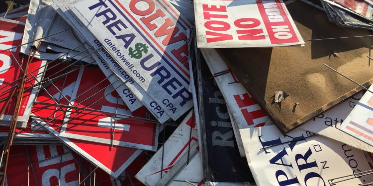 Scorched yard signs from the GOP headquarters in Hillsborough, NC. Photo credit: Dorothy Potter Snyder