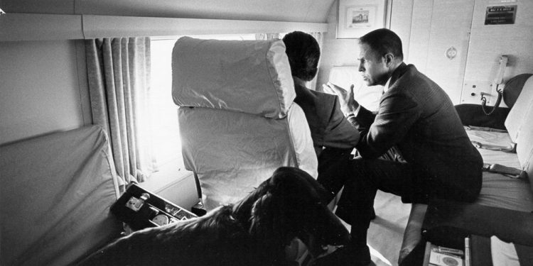 White House staffer H.R. Haldeman, right, confers with President Richard M. Nixon on board Air Force One during the Watergate Investigation, 1972 (Courtesy of the Richard Nixon Presidential Library and Museum and the National Archives Administration.)