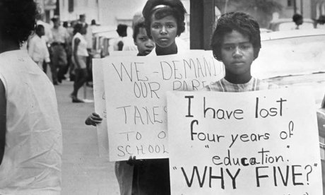 In 1963, African-American students protested as Prince Edward County, VA defied a court order to reopen its public schools, closed in 1959 to resist integration. (Courtesy National Archives)